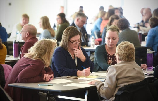 Participants join discussions in break-out groups Wednesday, Jan. 16, during a community conversation on health care in Central Minnesota at the Sauk Rapids Government Center.