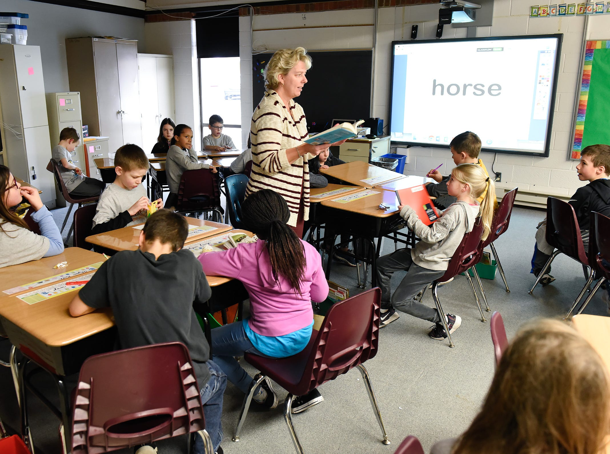 Teacher Val Martin has found a temporary home for her third grade class Tuesday, Jan. 15, since a fire damaged classrooms at Pleasantview Elementary School in Sauk Rapids.