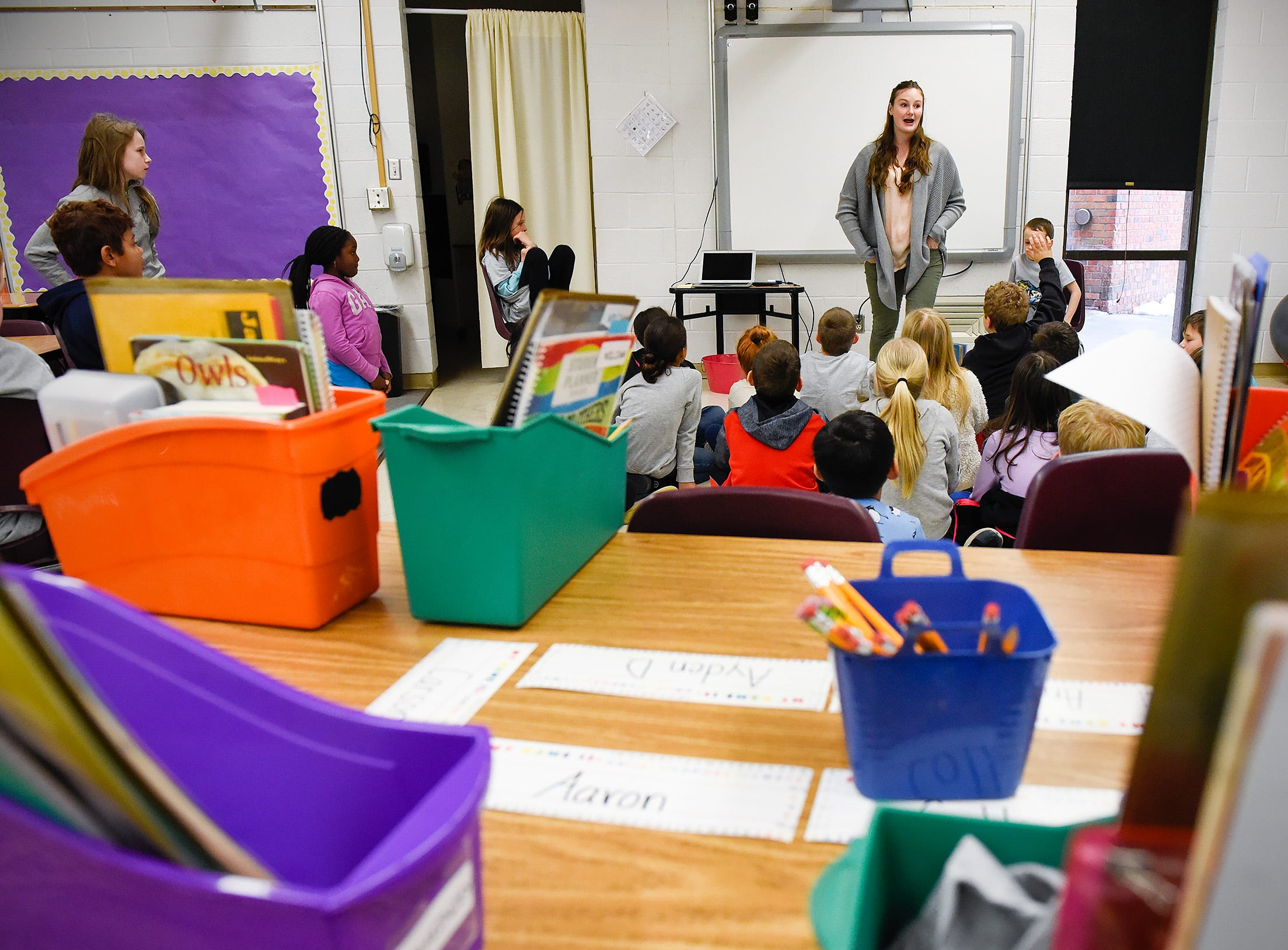 Teacher Emily Young talks with her students in a new classroom area Tuesday, Jan. 15, after a fire damaged classrooms at Pleasantview Elementary School in Sauk Rapids.
