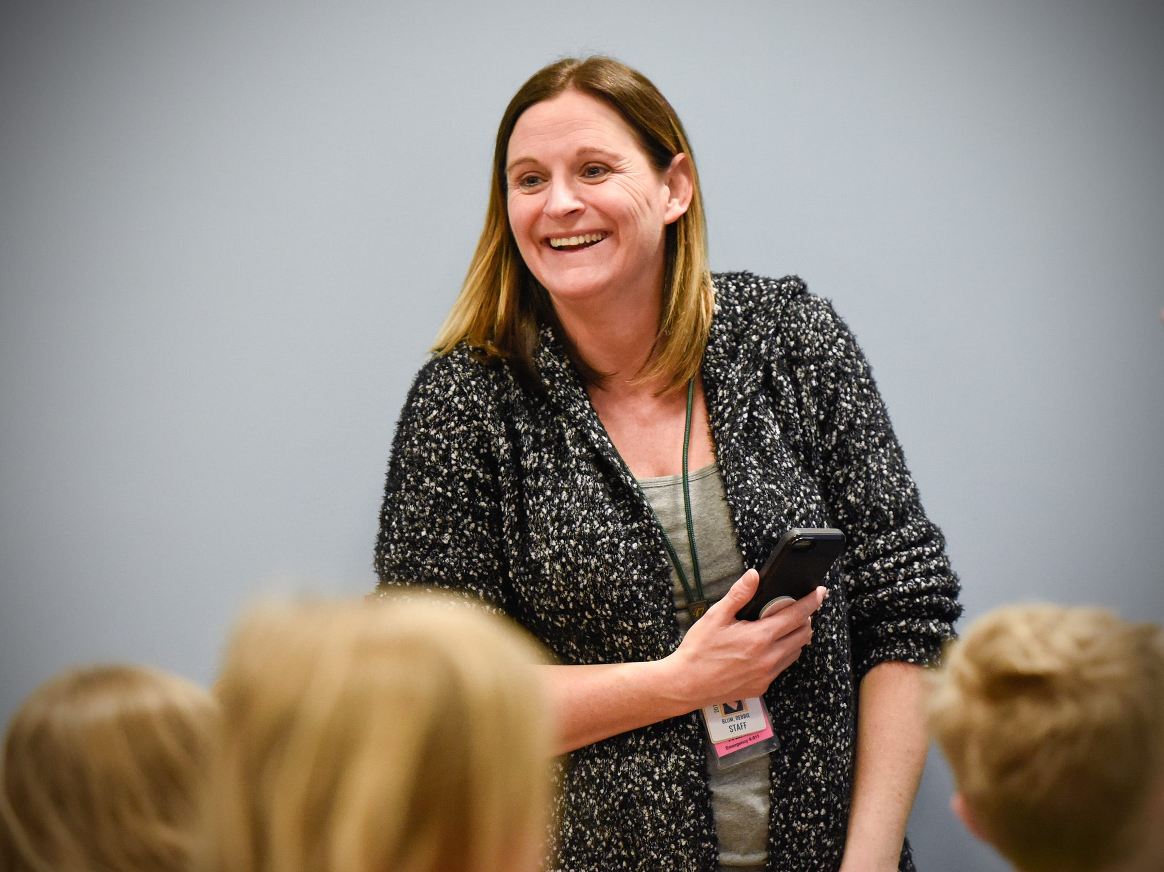 Teacher Deb Blum moved her third grade classroom to an area of the learning resource center Tuesday, Jan. 15, after a fire damaged classrooms at Pleasantview Elementary School in Sauk Rapids.