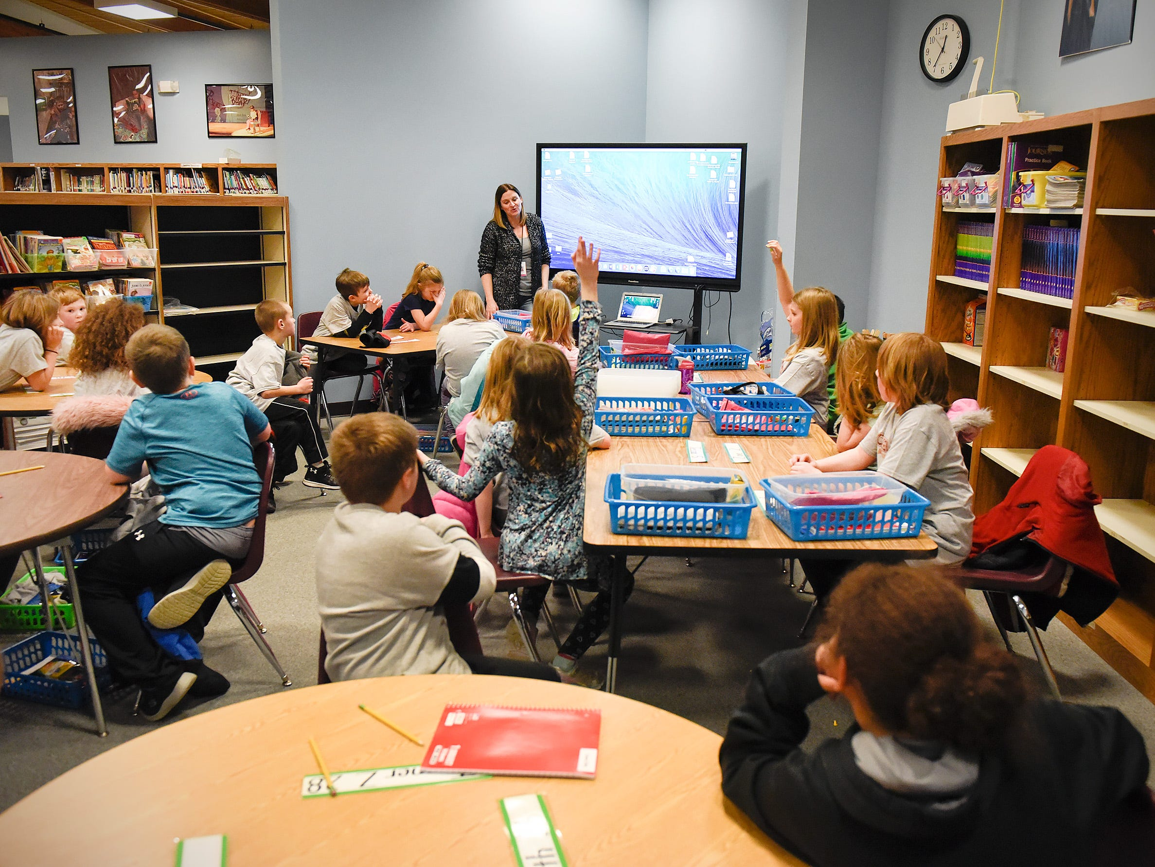 Teacher Deb Blum gets back to normal after moving  her third grade classroom to an area of the learning resource center Tuesday, Jan. 15, at Pleasantview Elementary School in Sauk Rapids.