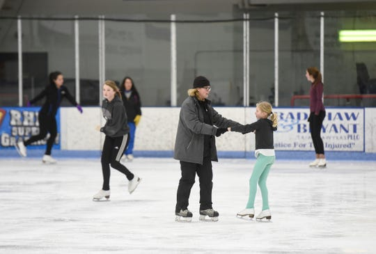 Instructors and students work together during a St. Cloud Figure Skating Club session Wednesday, Jan. 16, at the MAC in St. Cloud.