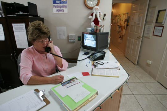 DOVE Center volunteer Martha Heuer works at the front desk in this Spectrum & Daily News file photo.