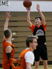 Iola-Scandinavia's Justin Sivertson shoots the ball during practice earlier this week.  The Thunderbirds enter the weekend with a 13-0 record, the program's best start in more than a decade.