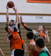 Iola-Scandinavia junior Connor Kurki pulls down a rebound during practice earlier this week. Kurki is one of the players on the team who was a part of the Thunderbirds state championship football squad this Fall.