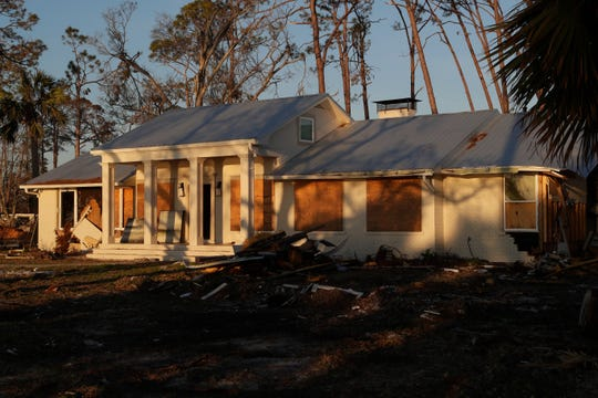 Three months after Hurricane Michael ravaged the coastline of U.S. Highway 98 in Port St. Joe, houses are seen with shattered and missing windows and doors, no signs of contractors or owners attempting to restore them.