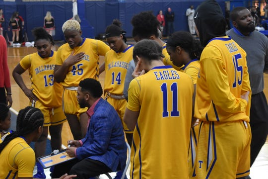TCC women's basketball head coach Franqua Bedell goes over strategy during a timeout. The Eagles fell to 18-3 and 0-3 in the Panhandle Conference following a 70-63 loss to Northwest Florida State College.