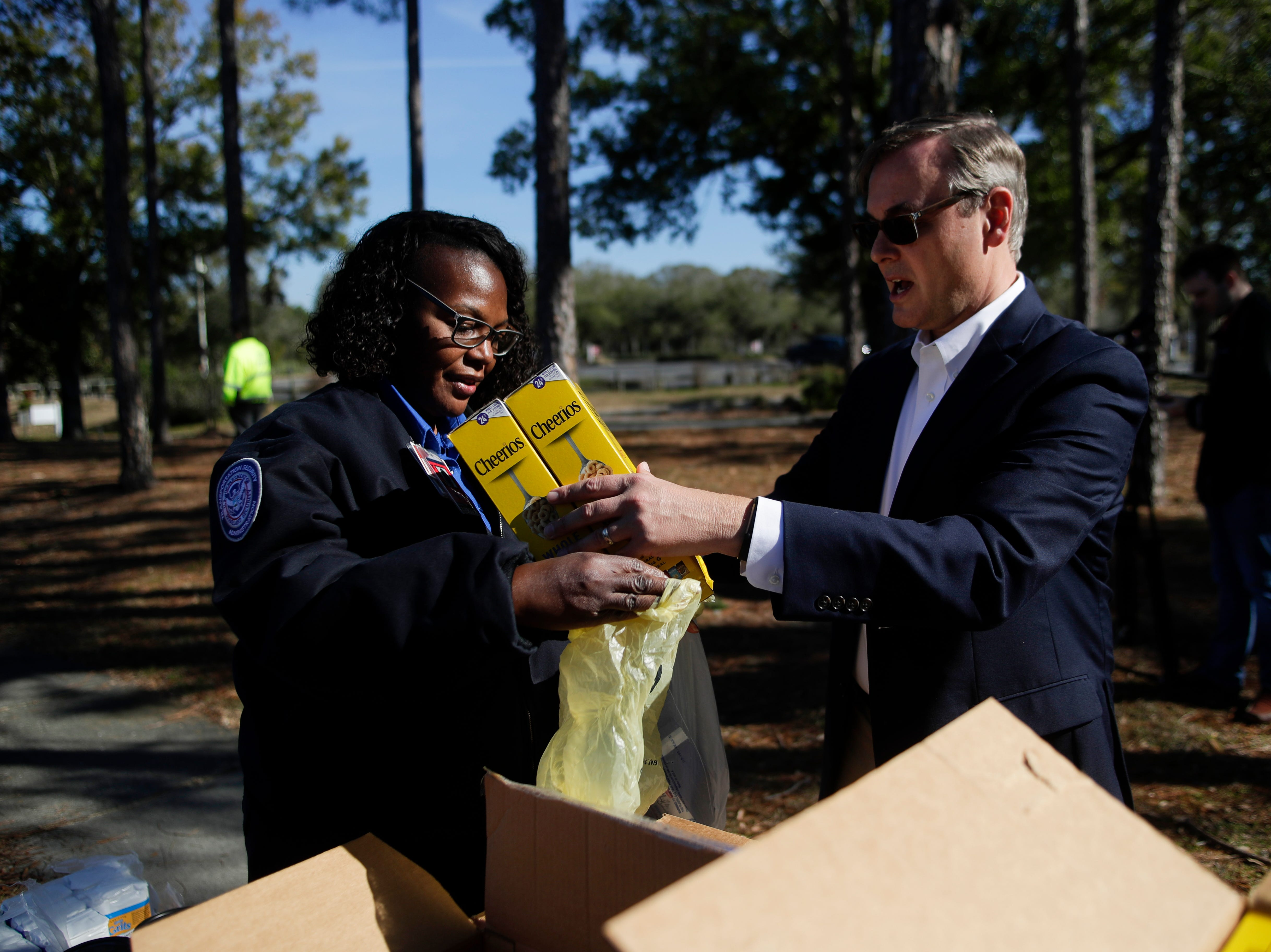 Second Harvest of the Big Bend CEO Rick Minor helps Transportation Security Administration employee Cartisha Dickson pack up two boxes of Cheerios into a bag as Second Harvest provides food to the 45 Transportation Security Administration  workers at the Tallahassee International Airport Thursday, Jan. 17, 2019.