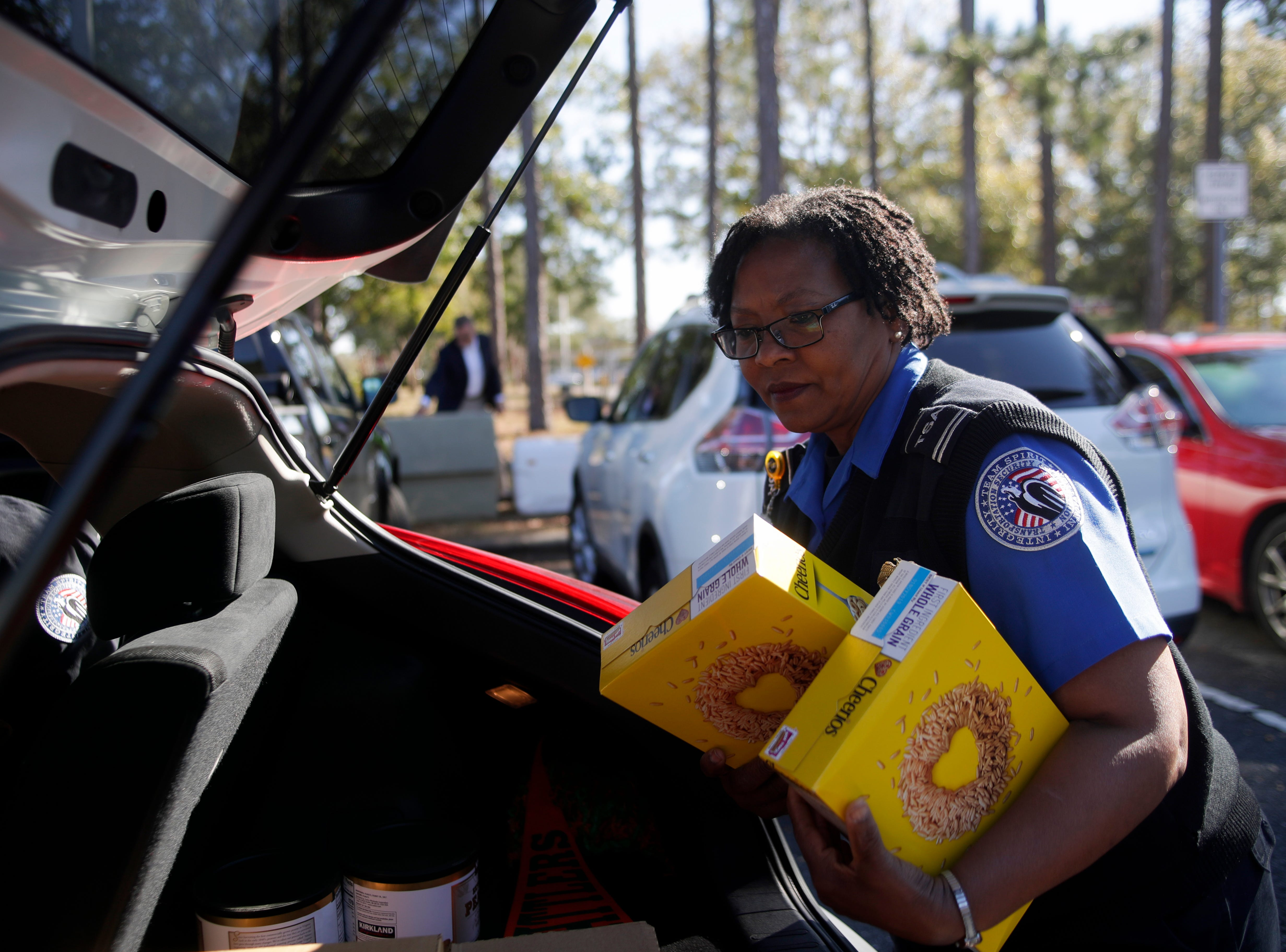 Transportation Security Administration employee Mae Speights loads Cheerios and other food donated to her by Second Harvest of the Big Bend at the Tallahassee International Airport Thursday, Jan. 17, 2019.