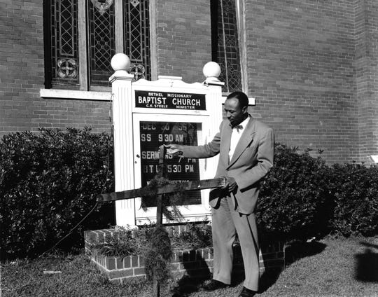 Bethel Missionary Baptist pastor the Rev. C.K. Steele examines a cross burned at his church in 1957. Steele was a civil rights activist, leader of Tallahassee?s 1956 bus boycott and a co-founder of the Southern Christian Leadership Conference, led by Martin Luther King Jr. Steele died in 1980.