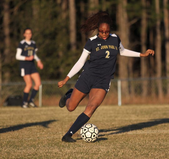 St. John Paul II senior Nina Ijeoma takes a shot during a game against Rickards on Wednesday during Senior Night. Ijeoma scored a goal despite her team being down three field players.