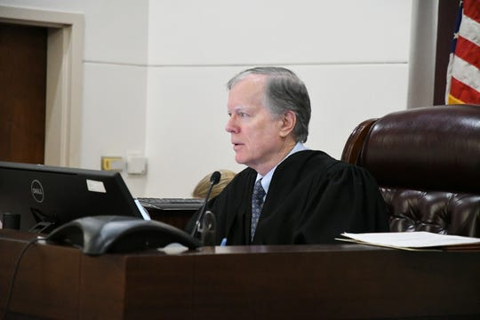 Leon Circuit Judge John Cooper presides over a hearing Thursday in Leon Circuit Court on whether the City Commission violated the Sunshine Law when it filled a vacant commission seat.