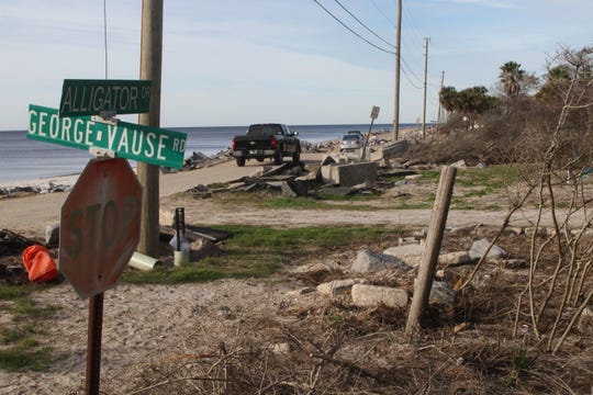 Vehicles drive along what is left of Alligator Drive, which has been left in disrepair by both Hurricane Hermine and Hurricane Michael. The county is looking at securing both state and federal funding to make permanent solutions.
