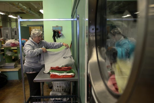 Dee Simms does laundry at The Laundry Basket in downtown Port St. Joe, a place that has been busy since Hurricane Michael devastated the community in October. The only laundromat in the area has become busy after the hurricane with workers from out of town needing a place to do their laundry as well as locals who had damage to their appliances during the storm.