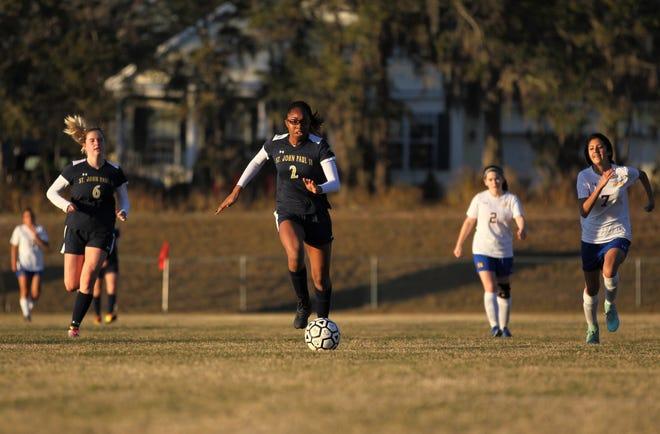 St. John Paul II senior forward Nina Ijeoma races towards a through ball during a game against Rickards on Wednesday.