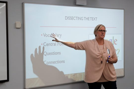 Tricia Rizza uses a SMART board in her instruction while teaching an integrated reading and writing course at Tallahassee Community College Thursday, Jan. 17, 2019.