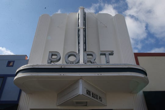 "The marquee at the Port Theatre in downtown Port St. Joe reads ""God bless PSJ"" three months after Hurricane Michael devastated the community in October."
