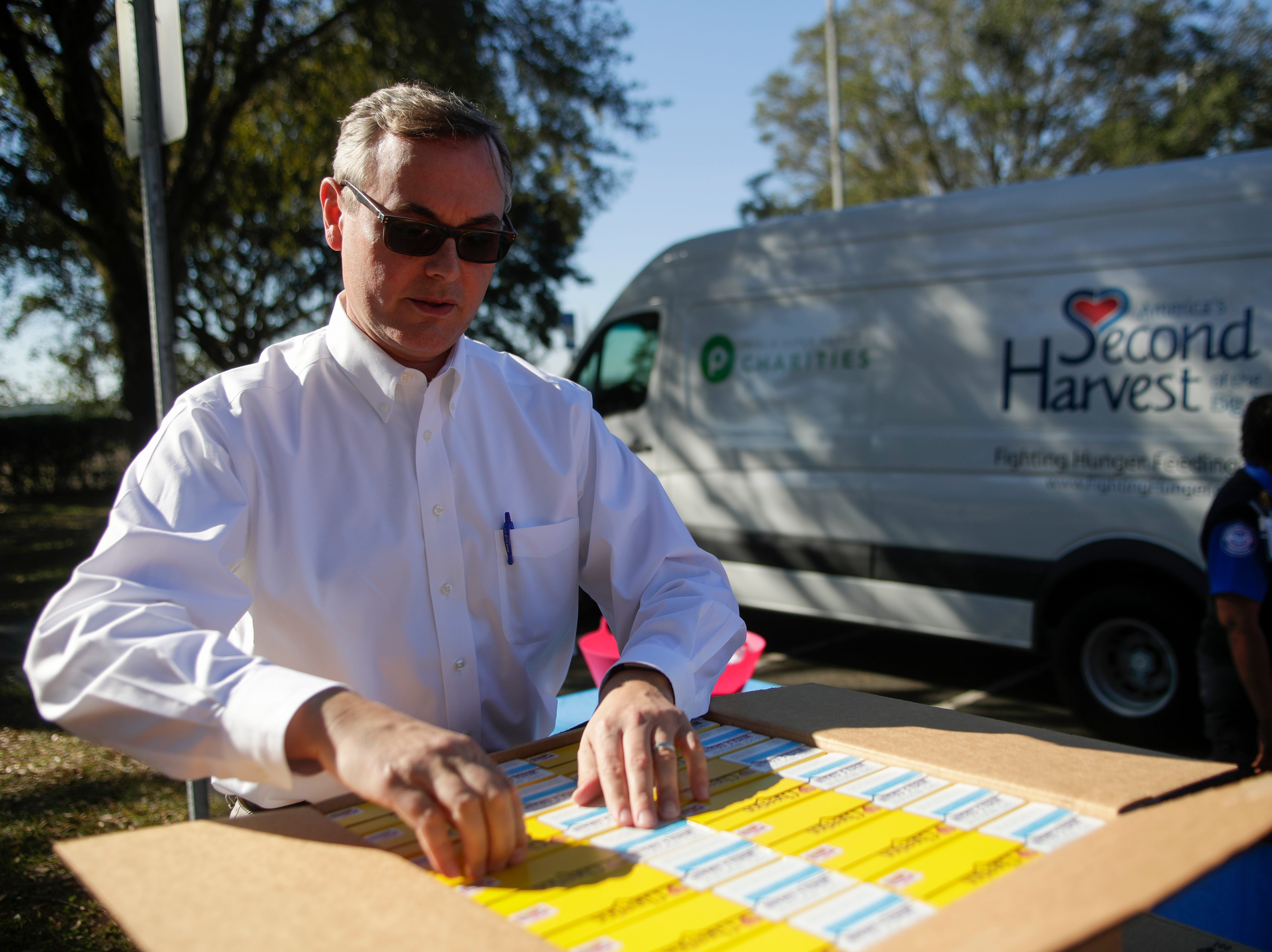 Second Harvest of the Big Bend CEO Rick Minor unpacks boxes of Cheerios to be given out to Transportation Security Administration employees at the Tallahassee International Airport Thursday, Jan. 17, 2019.