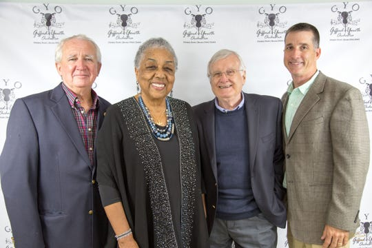 Gifford Youth Orchestra Executive Director Crystal Bujol, second from left, is surrounded by board members Jim Parks, left, Warren Obluck and Chair John Young.