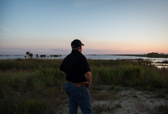 Jeff Leserra, a Fellsmere sportsman who manufactures gear for the outdoors industry, looks out over the 10,000-acre reservoir at the Fellsmere Water Management Area on Dec. 20, 2017, in Indian River County. Since breaking ground nearly a decade ago, the project - created to hold stormwater runoff and restore the headwaters of the St. Johns River - has cost taxpayers $53 million, and lacks a much-needed boat ramp, he said.