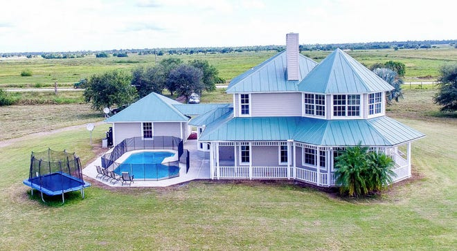This four-bedroom, three-bath home is part of a Martin County equestrian estate being auctioned off on Thursday.