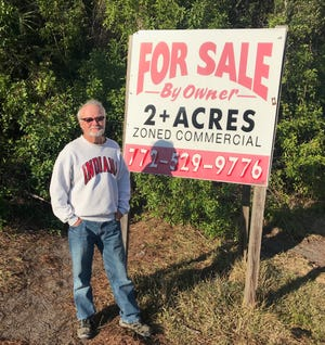 Landowner Billy Harper is trying to sell his property along Southeast Cove Road, but homeless camps inside the woods have made it impossible.