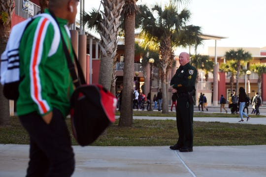 "St. Lucie County Sheriff's Office Master Deputy Jon Horowitz, one of two resource officers, patrols the courtyard of Fort Pierce Central High School as students change classes on Thursday, Jan. 17, 2019, in Fort Pierce. ""This is where it starts,"" Horowitz said, ""where we can be a positive role model for these kids. Yes, we are here for the safety and security of the students and the school, but we're also here to educate,"" Horowitz added. ""This is the best job in the department."""