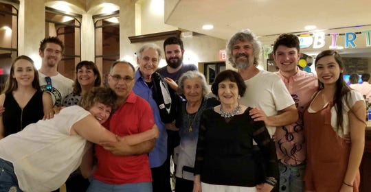 Telemachus Orfanos (back row, center) posed with his family at his grandfather's 90th birthday.