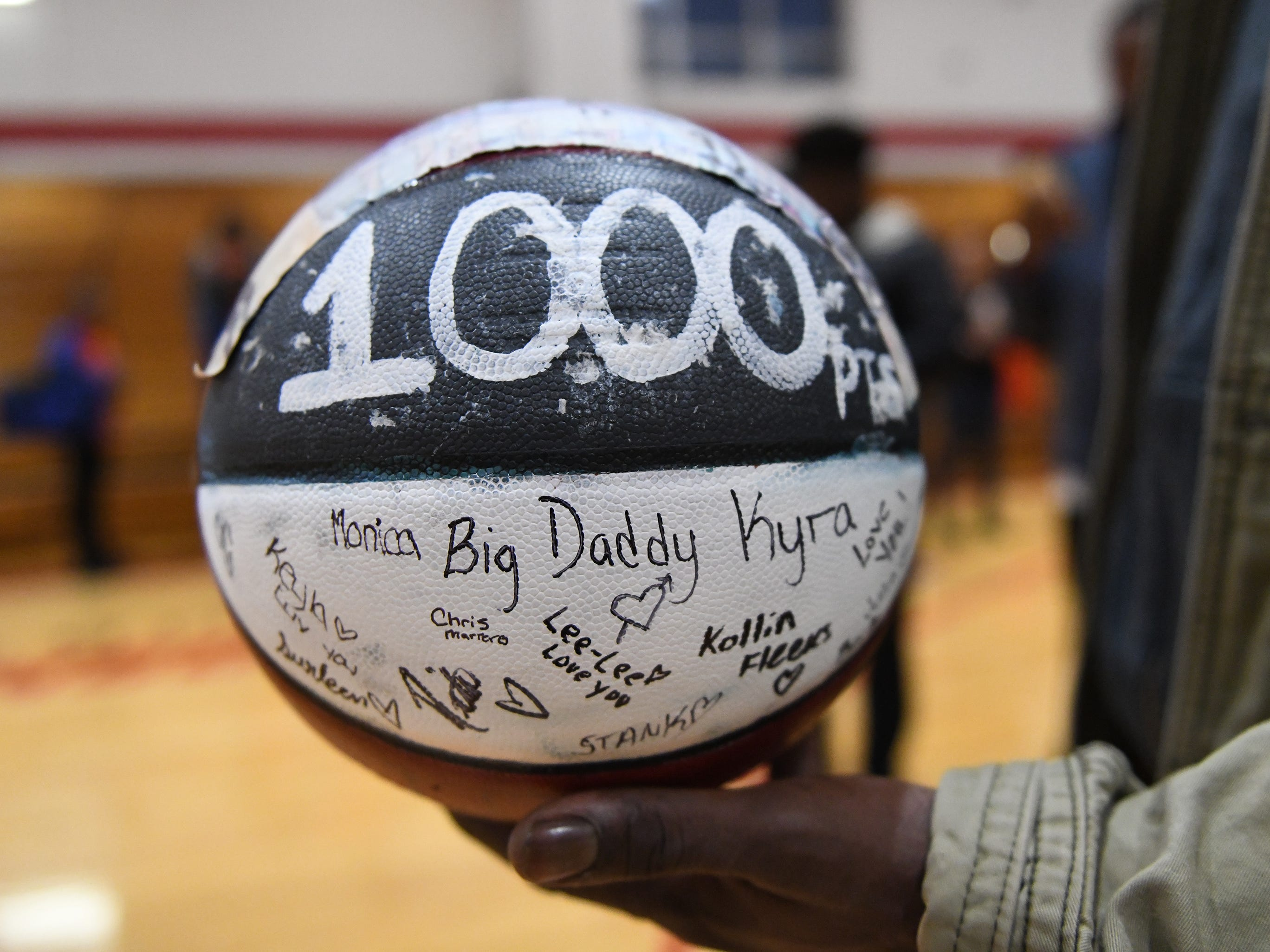 Briel Herbert's father, Neal, holds a painted basketball celebrating Briel's 1,000th career point after defeating visiting Millville 57-35 on Wednesday, Jan. 16, 2019.