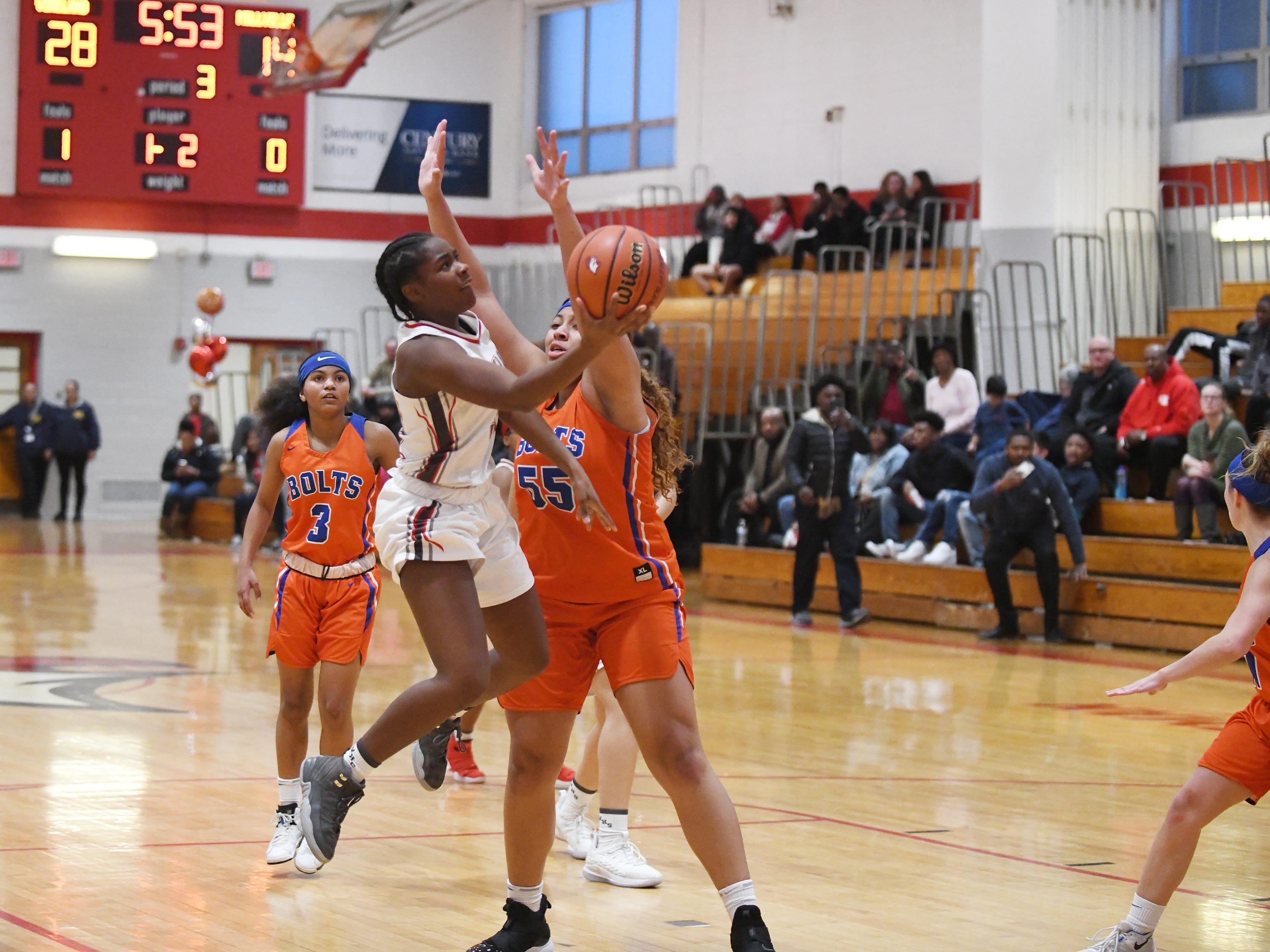 Vineland High School senior Briel Herbert scores her 1,000th career point on this shot against Millville. Vineland defeated Millville 57-35 on Wednesday, Jan. 16, 2019.