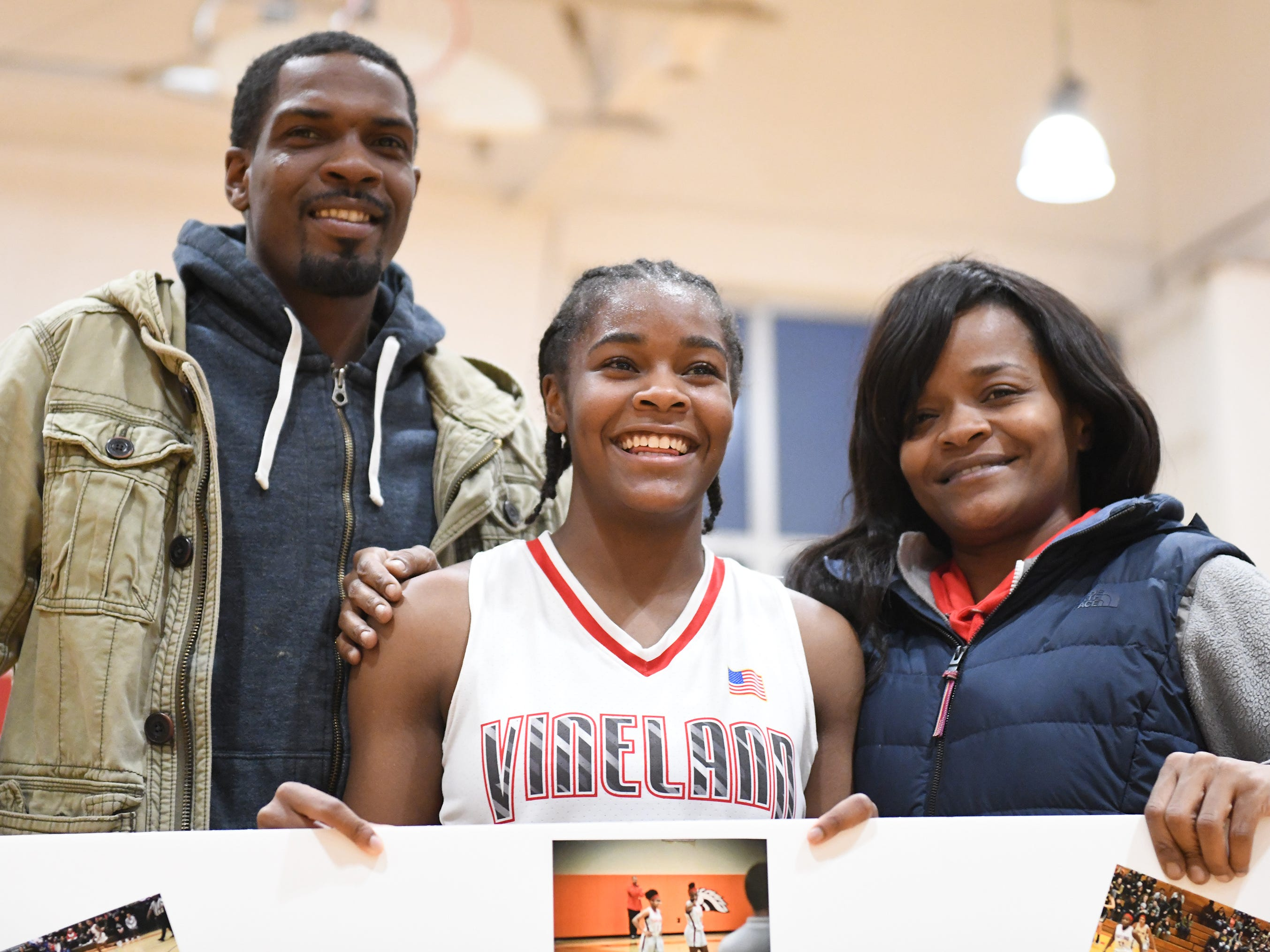 Vineland High School senior Briel Herbert celebrates her 1,000th career point with her parents Brenda and Neal Herbert after defeating Millville 57-35 on Wednesday, Jan. 16, 2019.