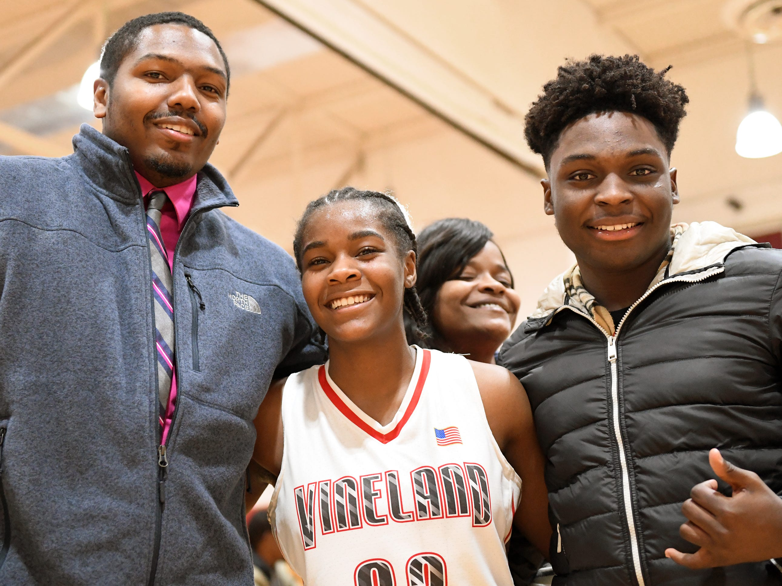 Vineland High School senior Briel Herbert celebrates her 1,000th career point with family and friends after defeating Millville 57-35 on Wednesday, Jan. 16, 2019.