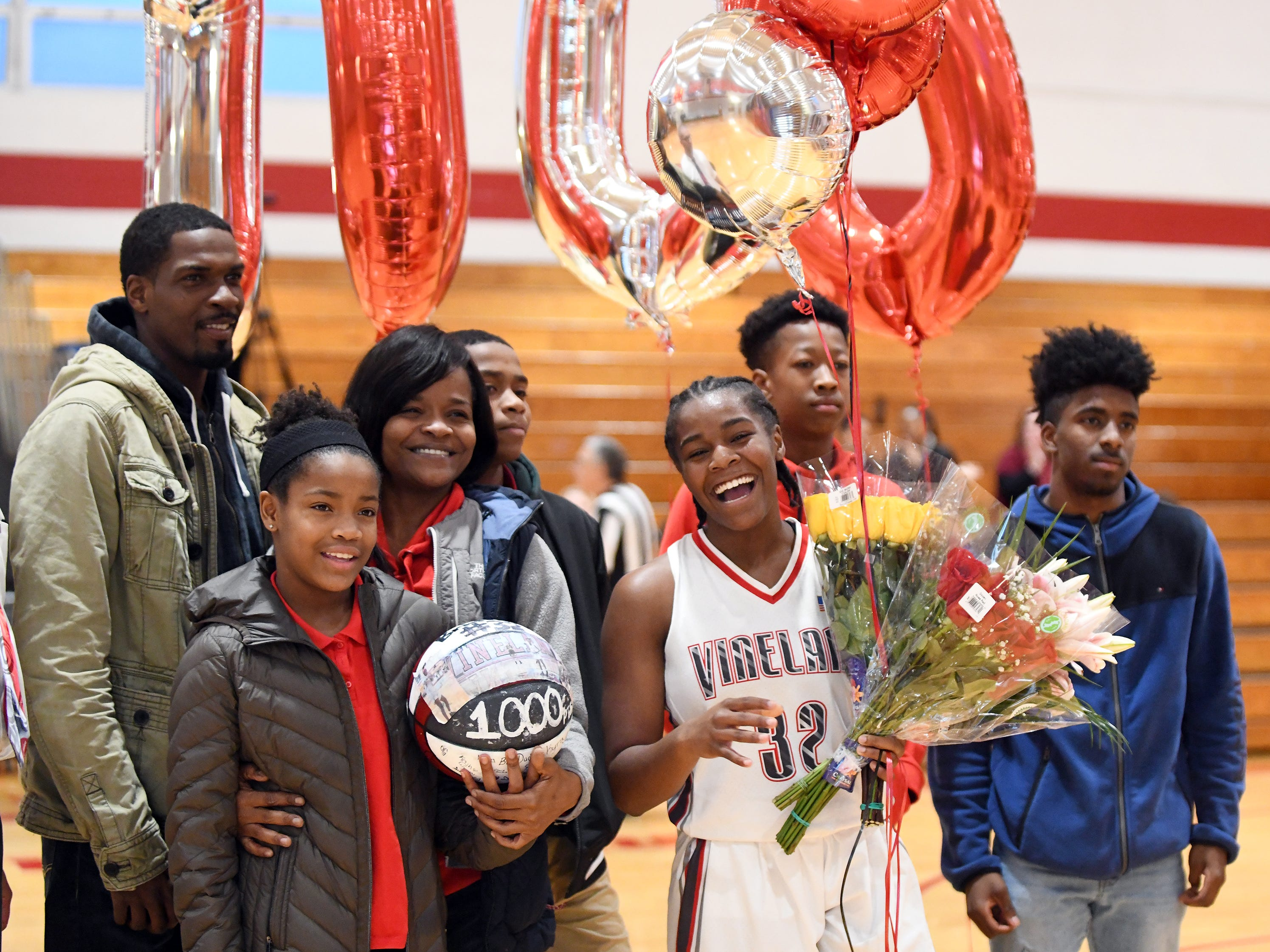 Vineland High School senior Briel Herbert and her family pose for a photo after Briel scored her 1,000th career point during a game against Millville. The Fighting Clan defeated the Thunderbolts 57-35 on Wednesday, Jan. 16, 2019.
