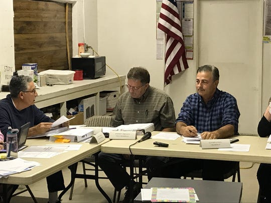 Tulare Cemetery board members Alberto Aguilar, Steve Presant and Xavier Avila, the board's chairman, at a meeting on Wednesday.