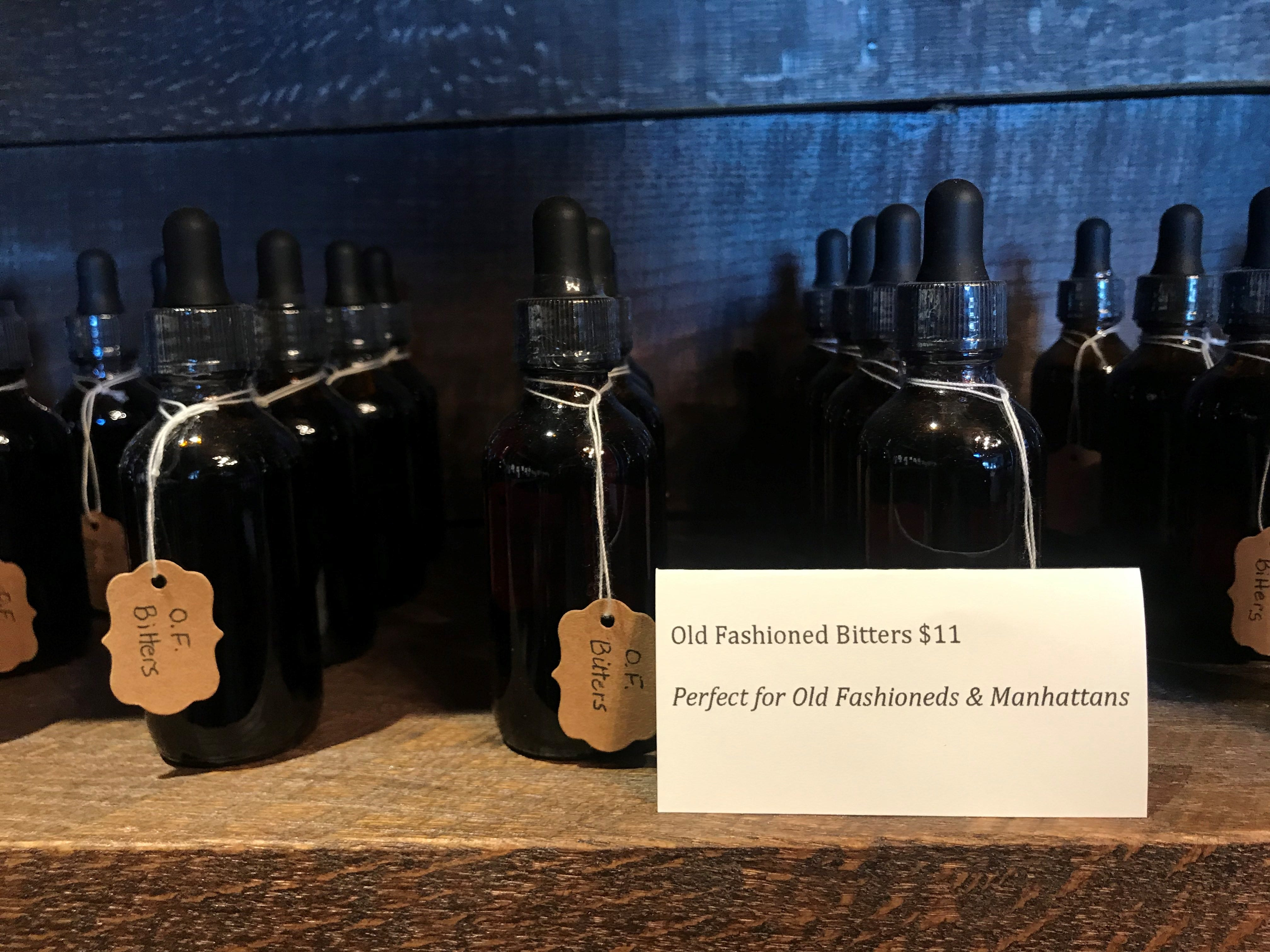 A for-sale section at Tine & Cellar, where customers can purchase house-made Old-Fashioned bitters and other local goods.
