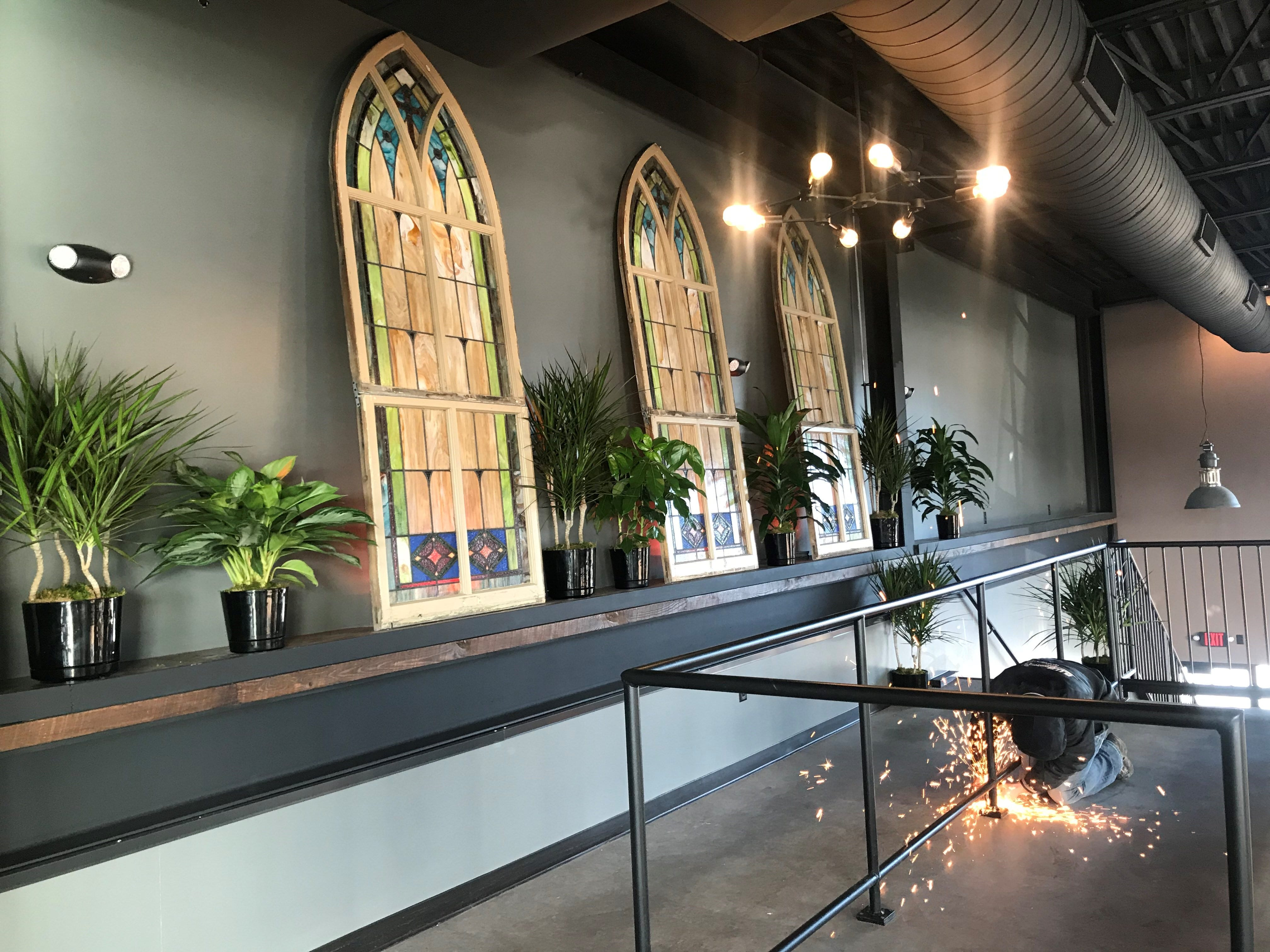 Finishing touches are put on the upper floor of Tine & Cellar, a new restaurant and bar in Weston. The stained glass windows come from an old church in Sheboygan Falls.