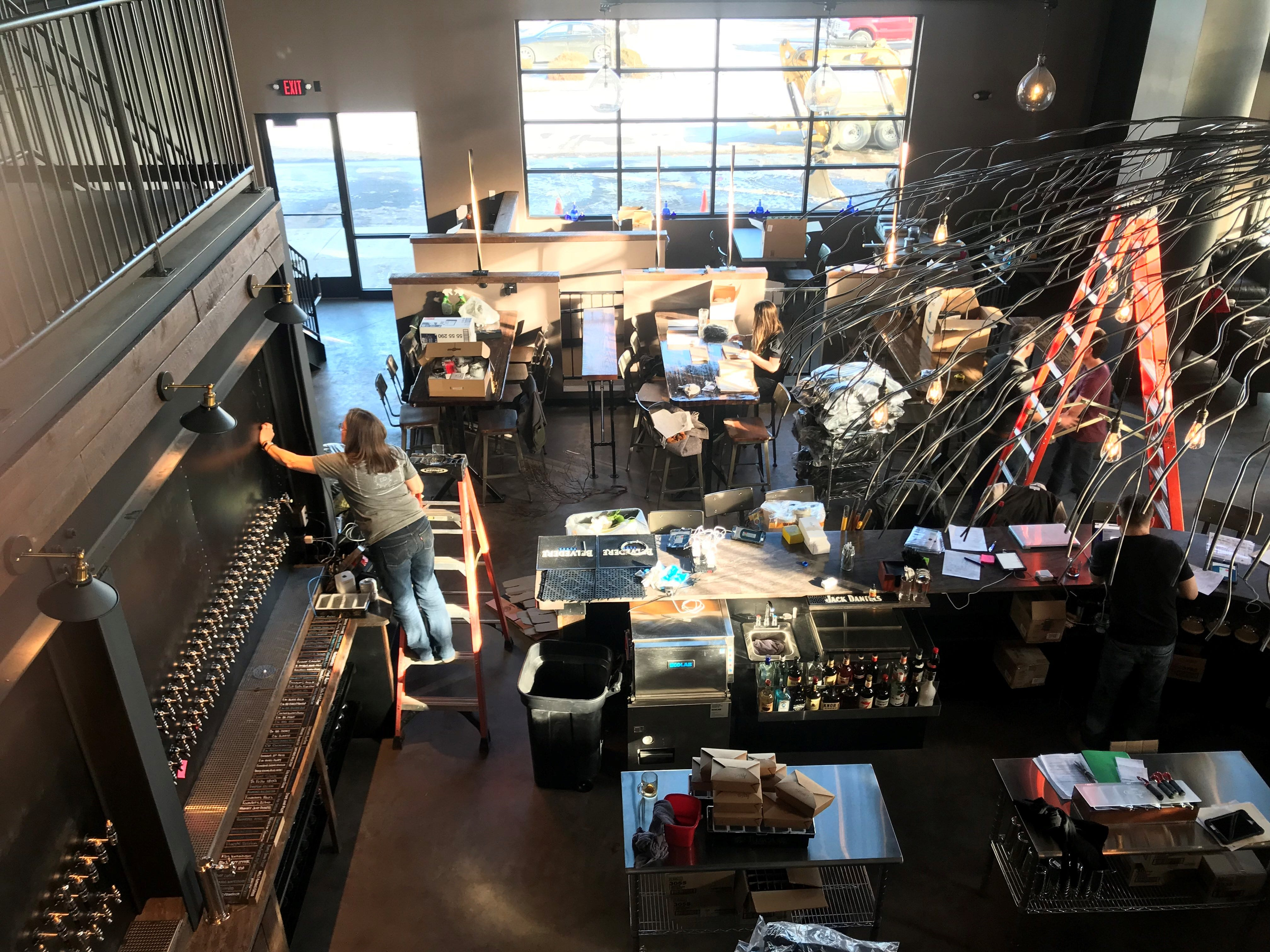 The team hard at work to prepare Tine & Cellar for its grand opening on Jan. 18.