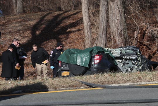 Westchester County police investigators on the scene of a fatal crash on the Saw Mill River Parkway northbound, north of Green Lane in Bedford Hills on Jan. 17, 2019.