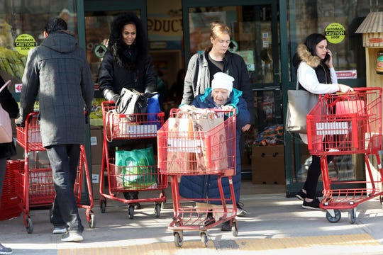 Anne Lavin, center, of New Rochelle and her friend Juliet Antelmi, left, also of New Rochelle leave Trader Joe's in Hartsdale after grocery shopping Jan. 17, 2019 in preparation for the weekend storm. Lavin said she got some basics like bread and milk since she probably won't be going during the storm.