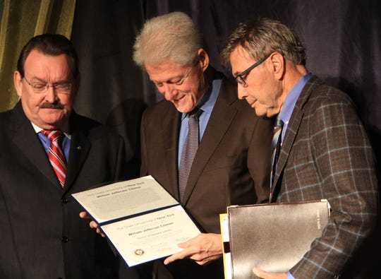 In 2013, Timothy Carey, then-chairman of the WCC Board of Trustees, and Joseph Hankin, then-Westchester Community College president, present former President Bill Clinton with an honorary  degree at WCC in Valhalla. (Frank Becerra Jr. / The Journal News )