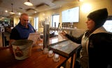 Beer lovers at the Captain Lawrence Brewery tasting room share their enthusiasm of tasting rooms.