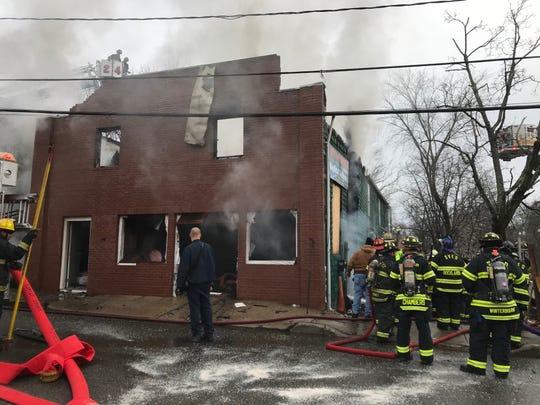 Firefighters battle a blaze in Spring Valley.