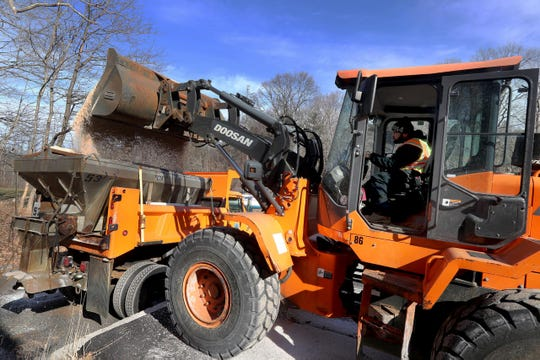 Juan Toribio of the Town of Ossining Highway Department loads trucks with rock salt Jan. 17, 2019. John Orlando of the highway department says that all the town's salt trucks will be ready to deal with this weekend's storms. He says that when the first storm of the season struck in November, many of the town's trucks were still being used for leaf pick-up and not prepared for snow removal.