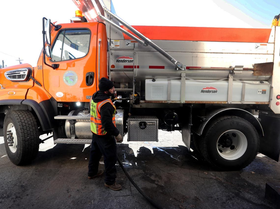 Juan Toribio of the Town of Ossining Highway Department loads a salt truck with liquid calcium Jan. 17, 2019. The liquid calcium gets added to the rock salt, making it more effective in melting ice and snow. John Orlando of the highway department says that all the town's salt trucks will be ready to deal with this weekend's storms. He says that when the first storm of the season struck in November, many of the town's trucks were still being used for leaf pick-up and not prepared for snow removal.