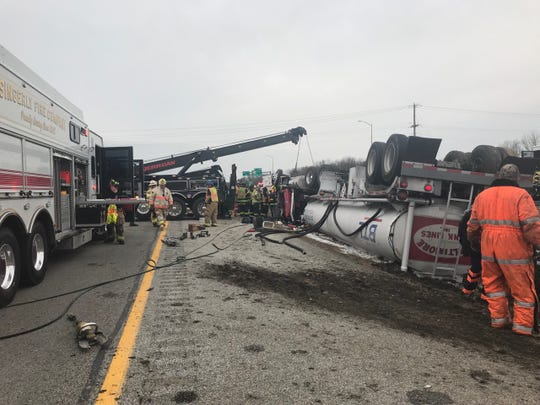 An overturned tank truck slows traffic on I-95 in Maryland.