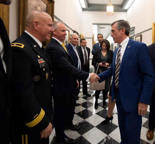 Governor John Carney arrives at Legislative hall to give his State of the State Address in the Senate Chambers.