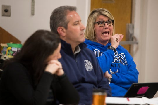 Odyssey Charter School Board member and science teacher Tami Soltow speaks during a meeting of the school board Wednesday night.