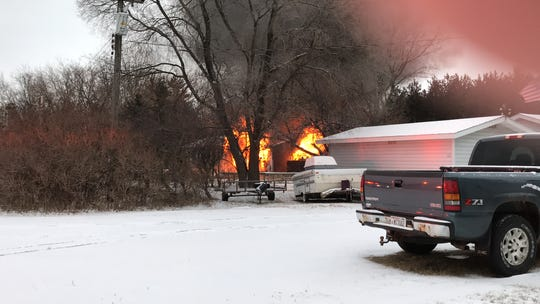 A blaze can be seen behind a home near State 54 west of Plover on Thursday, Jan. 17, 2019.