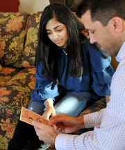 Rider High School, sophomore student, and Hospice of Wichita Falls volunteer, Manasvi Reddy, left, and Hospice director of development, Jake Truette, look over invitations to a dinner and benefit fundraiser, Reddy has been organizing, to help raise money for Hospice of Wichita Falls.
