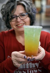 Carrie Gardner shows one of her tea bombs at Healthy's Downtown. Her newly-opened shakes and teas bar features a variety of meal replacement drinks and healthy teas.